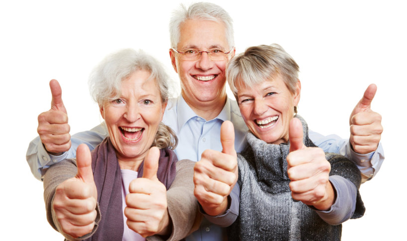 three happy people doing OK sign