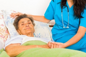 nurse with her patient who has terminal illness disease